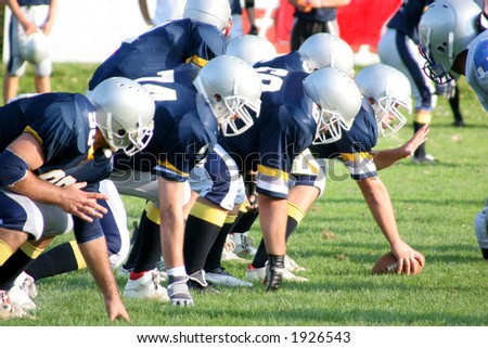 football players, offense – defense in action