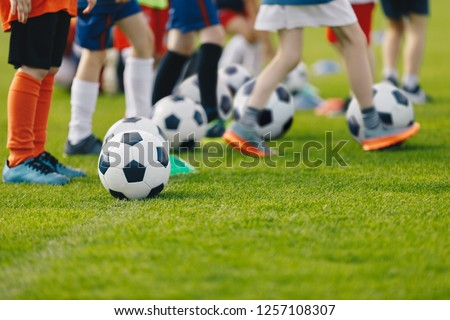 Blur of young kids playing a youth soccer match outdoors on