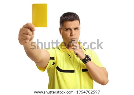 Football referee blowing a whistle and showing a yellow card isolated on white background