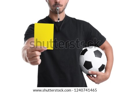 Football referee with ball holding yellow card on white background, closeup