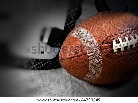 Football set on a tan set with soft focus and copy space