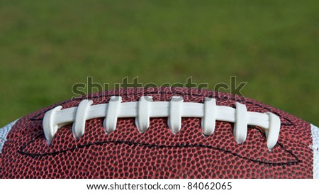 Football sitting on a grass background