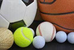 Football, soccer ball, basketball, american football, golf ball, baseball, tennis ball set on white background.