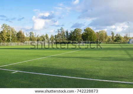 football soccer field with blue sky