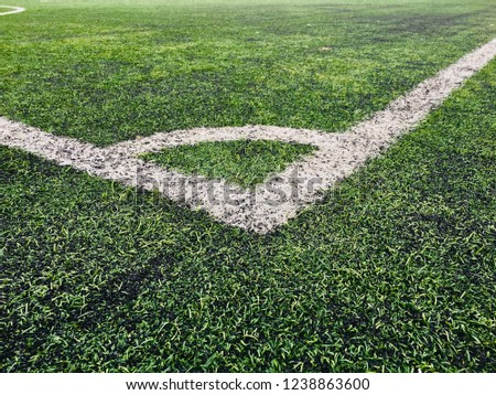 Football soccer field with white marks on green grass. Blank space and nobody in photo.