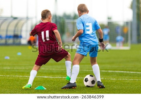 Football soccer game. Running players footballers boys playing soccer match