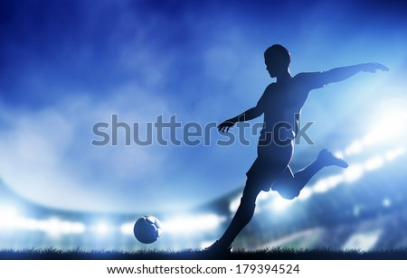 Shutterstock Football, soccer match. A player shooting on goal. Lights on the stadium at night.