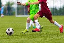 Football soccer match. Boys playing soccer game