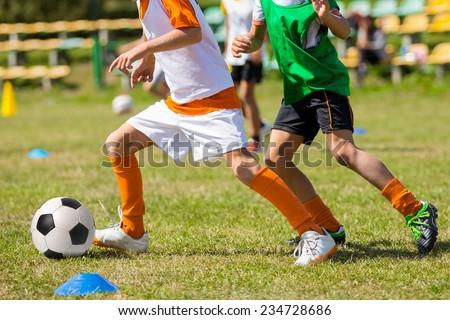 Football soccer match for children. kids playing soccer game tournament