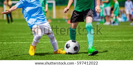 Football Soccer Match for Children. Kids Playing Soccer Game Tournament. Boys Running and Kicking Football on the Sports Grass Field #597412022
