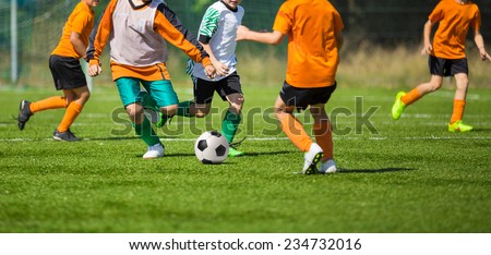 Football soccer match for children. kids playing soccer game tournament. physical education classes at school.