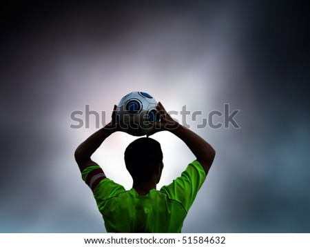 Football, soccer player throws in the ball
