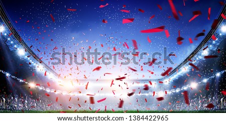 Football stadium background with flying confetti #1384422965