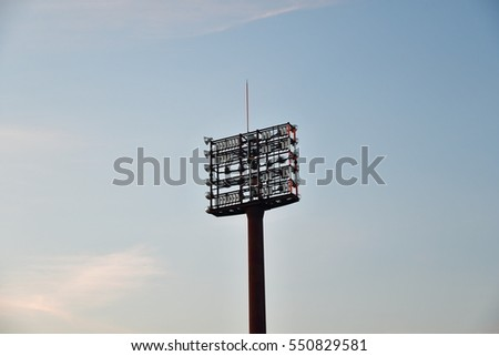 football stadium light structure on stand roof in sunset #550829581
