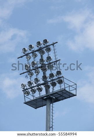 Football stadium lights on blue sky