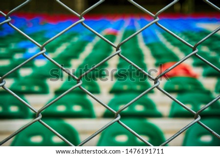 football stadium rostrum with red and blue green seats with containment wing #1476191711
