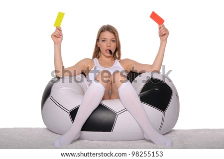 Football supporter with red and yellow cards on white background