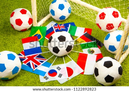 Football team. Soccer balls in the stadium. Flags of countries surrounded by balls. International football games.