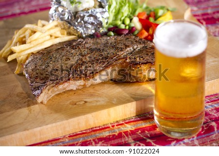 football time, set of beef steak and beer on the table