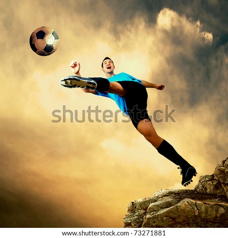 Footballer on the top of mountain