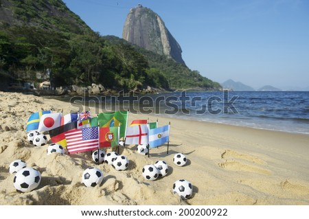 Footballs and international flags on Praia Vermelha Red Beach at Sugarloaf Mountain Rio de Janeiro Brazil