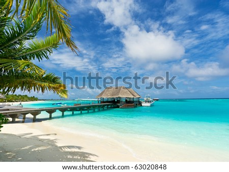 footbridge connecting with the thatched jetty in maldives island resort