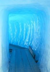 Footbridge inside the ice cave (Eisgrotte am Rhonegletscher) on Furka Pass,  Alps, Valais, Switzerland