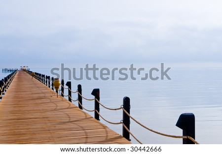 footbridge jetty on tropical sea at morning