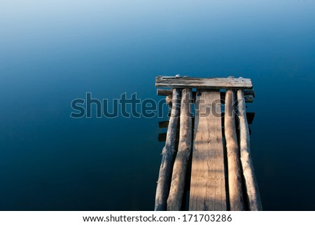Footbridge over the smooth water.