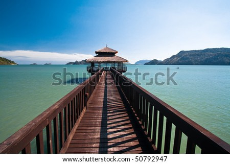 footbridge over turquoise ocean on an island