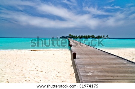 footbridge over turquoise ocean on an maldivian island - stock photo