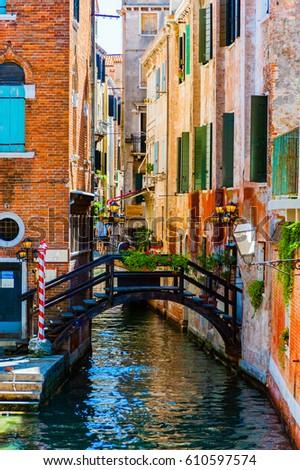 Footbridge over venetian Canal Italy #610597574