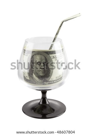 "Footed glass with one hundred dollars inside and with ""drinking straw"" isolated on white. Business and finance or concept."