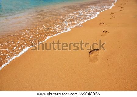 Footmarks on a sandy beach