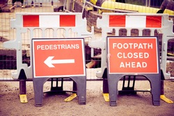 Footpath closed sign for pedestrian safety from road construction