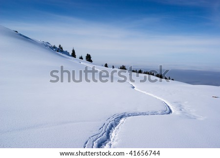 Footpath in winter mountains