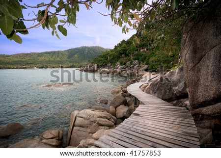 footpath to a clear mountain lake