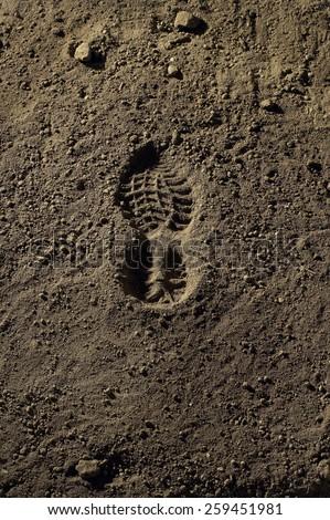 footprint in the dirt.