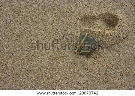 Footprint of a kid in the sand
