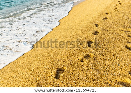 Footprint on sand with foam