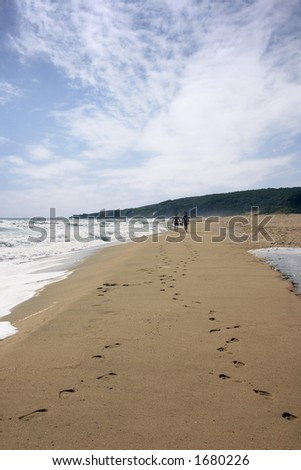 Footprint on sands. Two men walking beach.