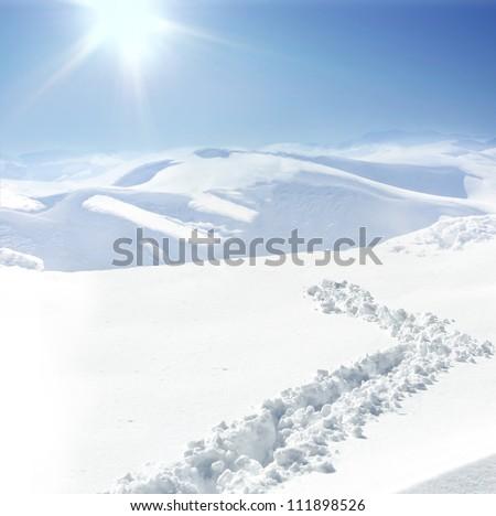 Footprint on snow mountain hill