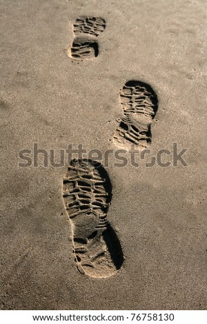 footprint shoe on beach brown sand texture print perspective