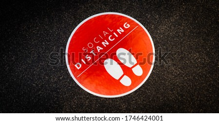 Footprint sign for stand in the mall.Social Distance word sticker poster.Social Distancing 6 Ft. Instruction against the Spread.New normal Reopen Mall.Social distancing in the workplace during covid19