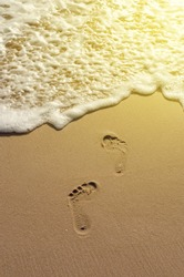 Footprints in sand on the beach, Afternoon of summer, Color filtered image.