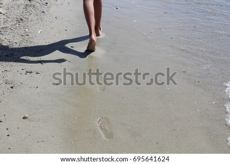 footprints in the sand #695641624