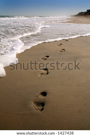 Footprints in the sand along the shore - An updated, more vivid version.