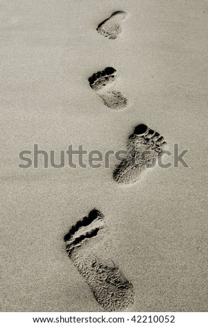 footprints in the sand black and white