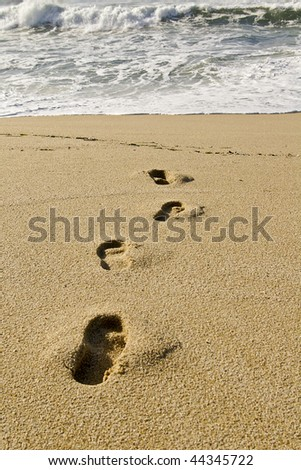 Footprints in the sand. Near the water