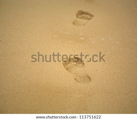 Footprints in the sand on Mombasa beach Kenya Africa